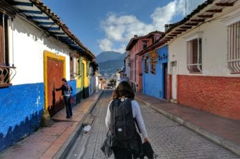 A backpacker walks by a healthcare clinic in Colombia