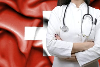 Swiss doctor with flag of Switzerland