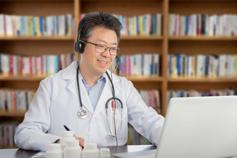 South Korean doctor on computer