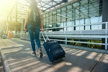traveler with luggage and backpack