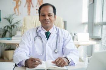 Indian doctor sitting at desk