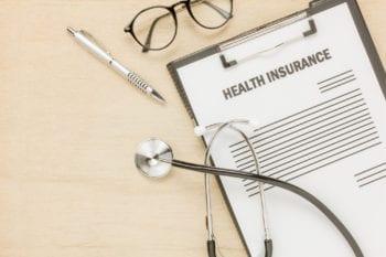 health-insurance-form-eyeglasses-with-stethoscope