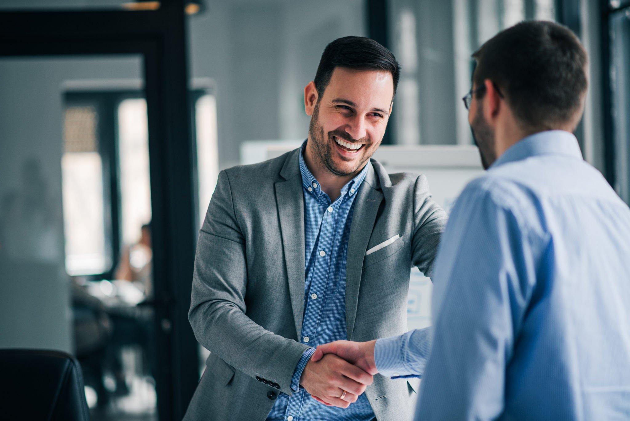 professional insurance broker shaking hands