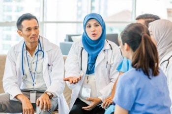 Malaysian doctors conducting a briefing