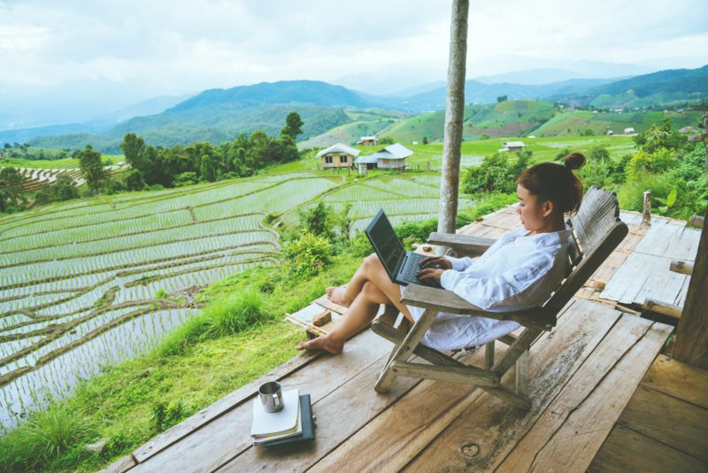 female expat working on laptop in thailand