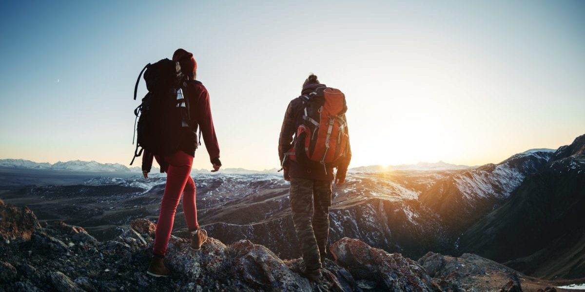 two hikers participating in an adventurous hike